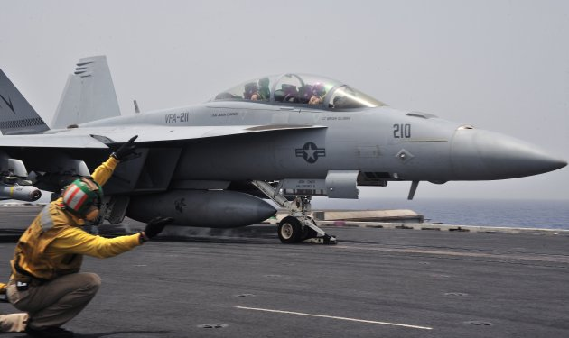 US Navy 110620 N OP638 047 An F A 18E Super Hornet assigned to the Checkmates of Strike Fighter Squadron VFA 211 launches from the aircraft carri